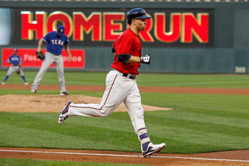Minnesota Twins Brian Dozier runs the bases on his second home run of the night against Texas Rangers starting pitcher Martin Perez in the second inning of a baseball game Friday, Aug. 4, 2017, in Minneapolis. (AP Photo/Bruce Kluckhohn)