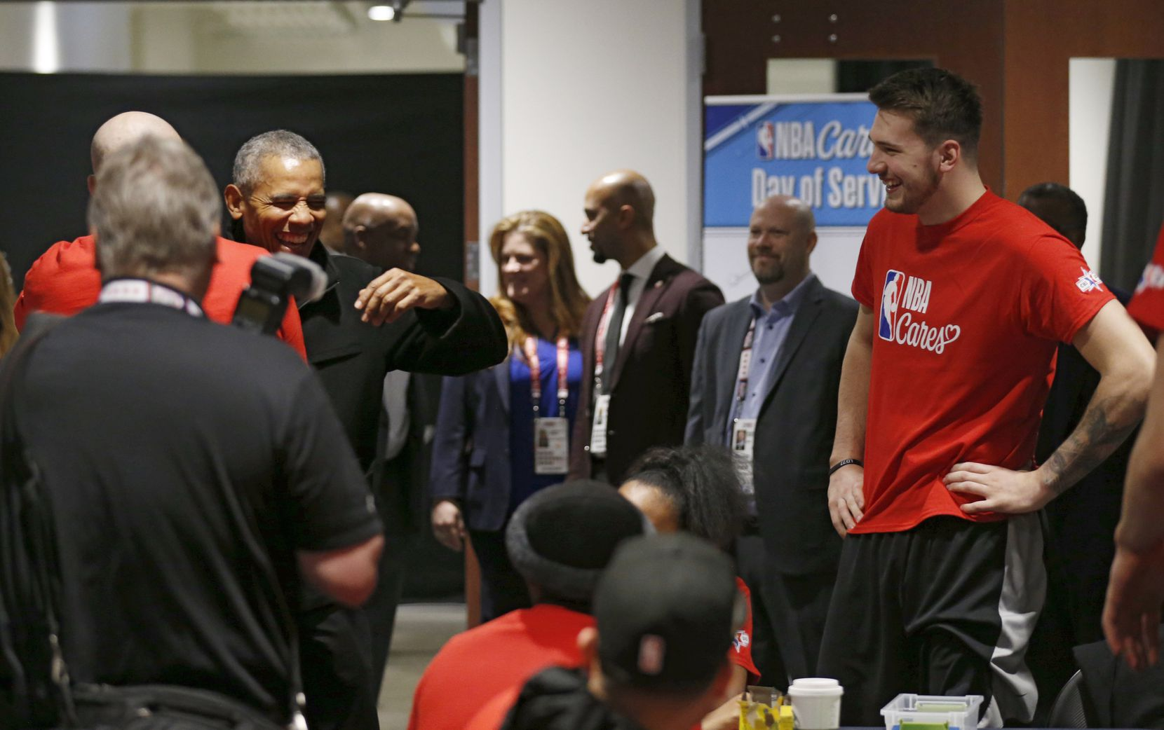 Former President Barack Obama jokes with Los Angeles Lakers assistant coach Jason Kidd as Dallas Mavericks forward Luka Doncic (77) looks on during a NBA Cares Day of Service event during NBA All Star 2020 at Wintrust Arena in Chicago on Friday, February 14, 2020.