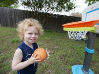 Luka Miller, 2, named after Dallas Mavericks' guard Luka Doncic, plays basketball in his backyard at his home in Glenn Heights, Thursday, May 13, 2021.(Brandon Wade/Special Contributor)