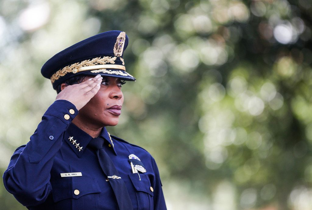 Dallas Police Chief U. Renee Hall salutes for the national anthem during an unveiling ceremony for a memorial in honor of the five officers who died on July 7, 2016 at the Jack Evans Police Headquarters in Dallas on Monday, July 8, 2019.