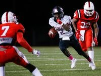 Lake Highlands Noelle Whitehead (2) evades the Irving MacArthur defense during a the fourth quarter of a high school football game at Joy & Ralph Ellis Stadium in Irving on Friday, Oct. 23, 2020. Lake Highlands won the game, 44-19.