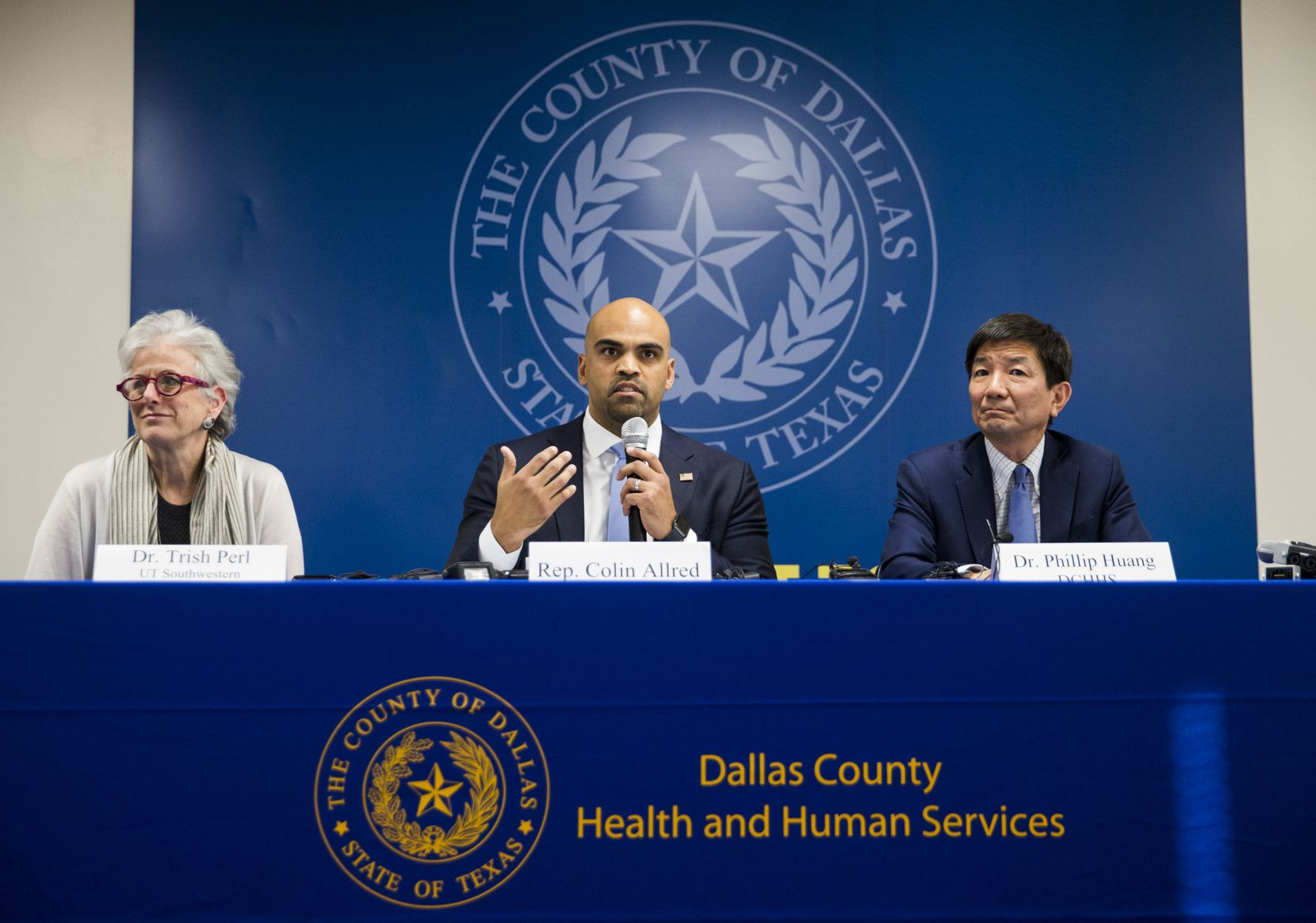 """Rep. Colin Allred, D-Dallas, (center) said he was proud to be the first African-American to represent the 32nd Congressional District. He said he's """"used that perspective to try to serve everyone."""" (Ashley Landis/The Dallas Morning News)"""