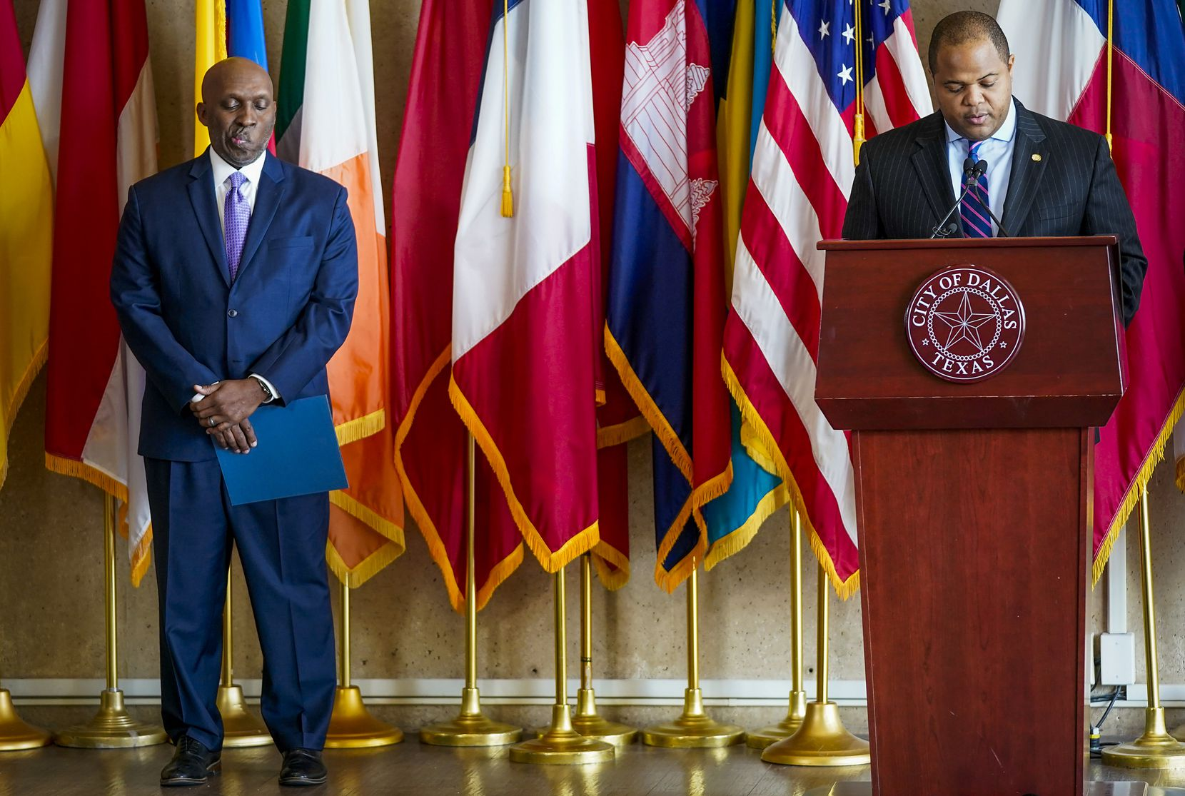 Dallas City Manager T.C. Broadnax (left) listened during a March 16 news conference at City Hall as Dallas Mayor Eric Johnson announced that the city would limit gatherings to 50; close bars, fitness facilities and amusement centers; and limit restaurants to takeout, delivery and drive-through only in response to the pandemic.