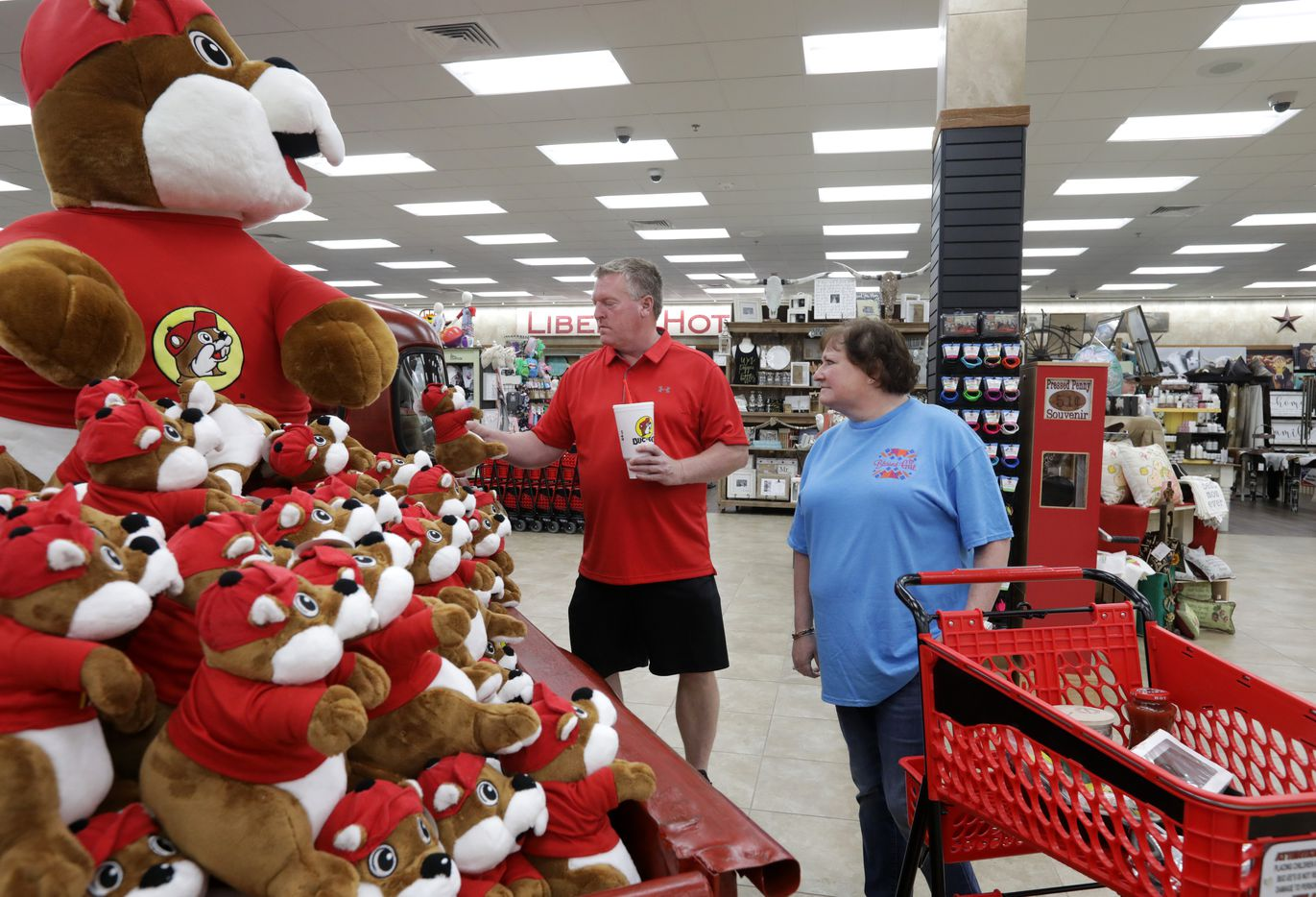 Randy Hayes, left, and Angie Hayes look at Buc-ee's beaver mascots while shoppinig at the new Buc-ee's in Melissa, TX, on Apr. 29, 2019.