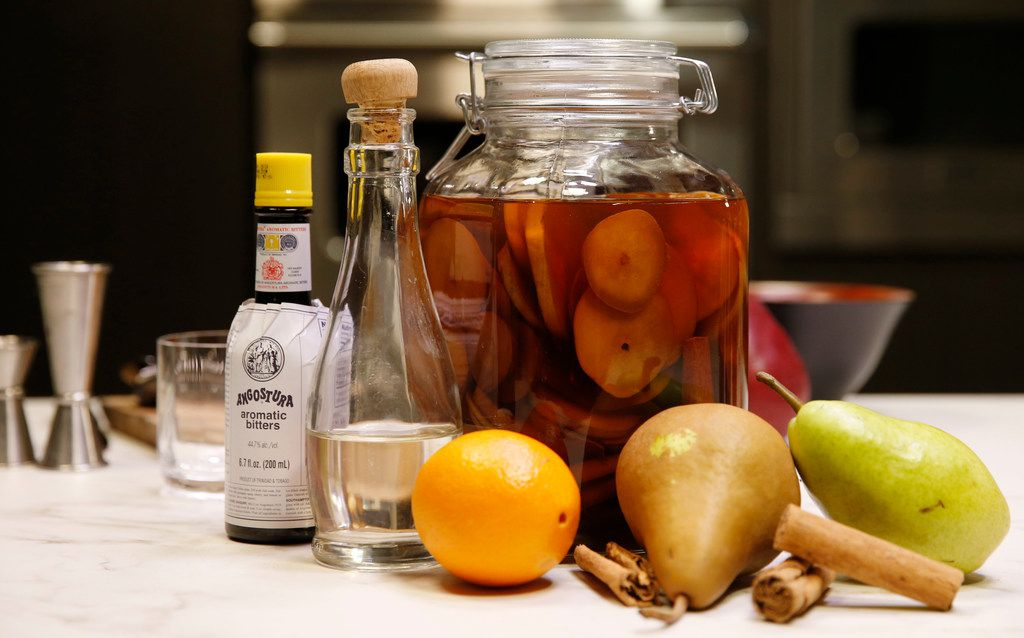 Bitters, simple syrup, orange and bourbon infused with cinnamon and pears for use in a Cinnamon Pear Old-Fashioned