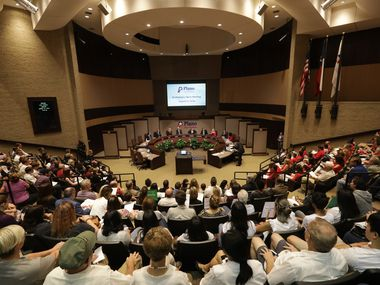 This file photo shows community members attending a 2019 city council meeting at the Plano Municipal Center in Plano.