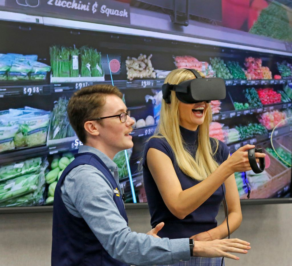 First daughter Ivanka Trump gets some in-store virtual reality training from Walmart's James Mitchell, left, as she visits the Walmart off Highway 80 in Mesquite to participate in a tour and discussion with Walmart Academy students and facilitators, and employees at the store, photographed on Thursday, September 20, 2018. (Louis DeLuca/The Dallas Morning News)