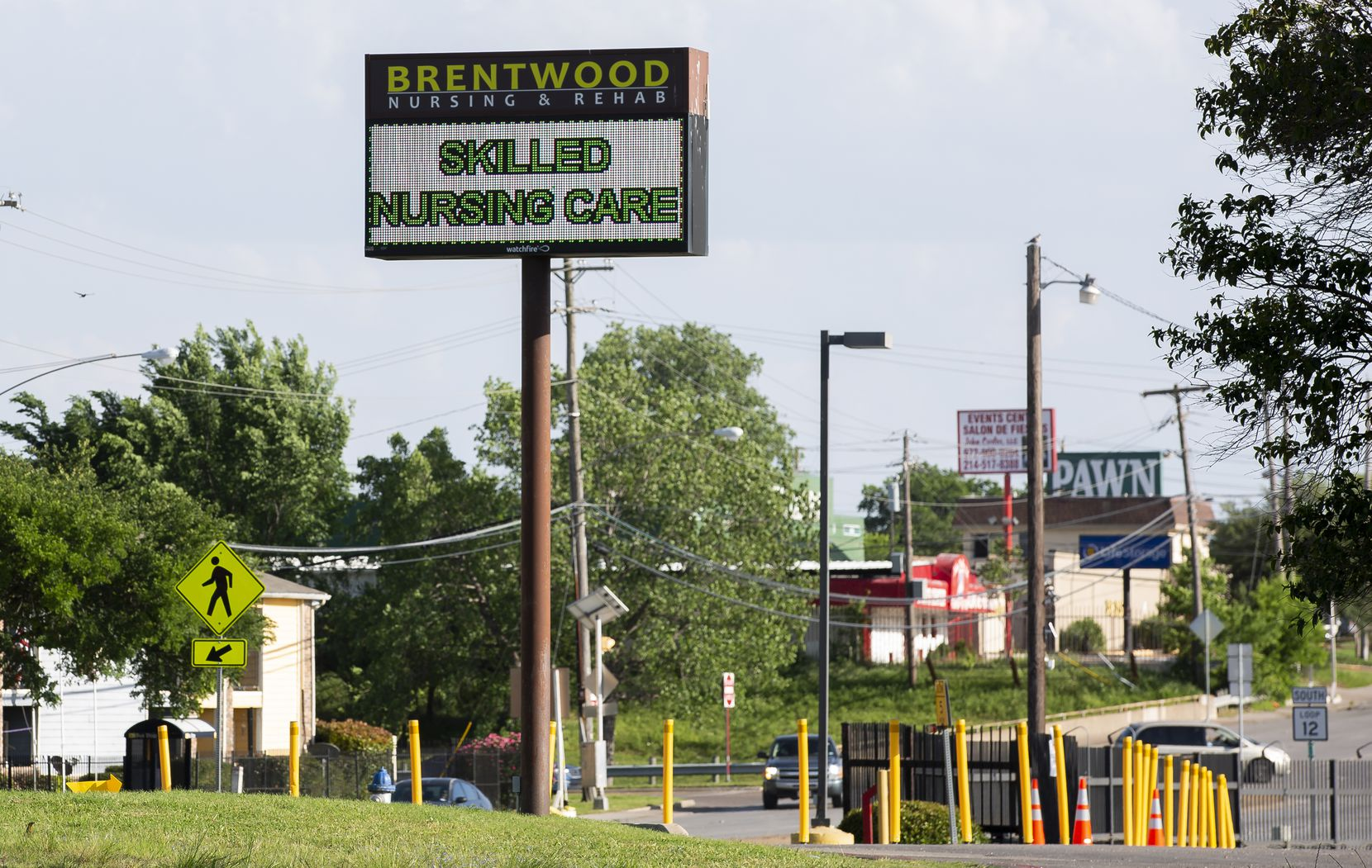 A sign outside of Brentwood Nursing & Rehab on April 24, 2020 in Dallas. (Juan Figueroa/ The Dallas Morning News)