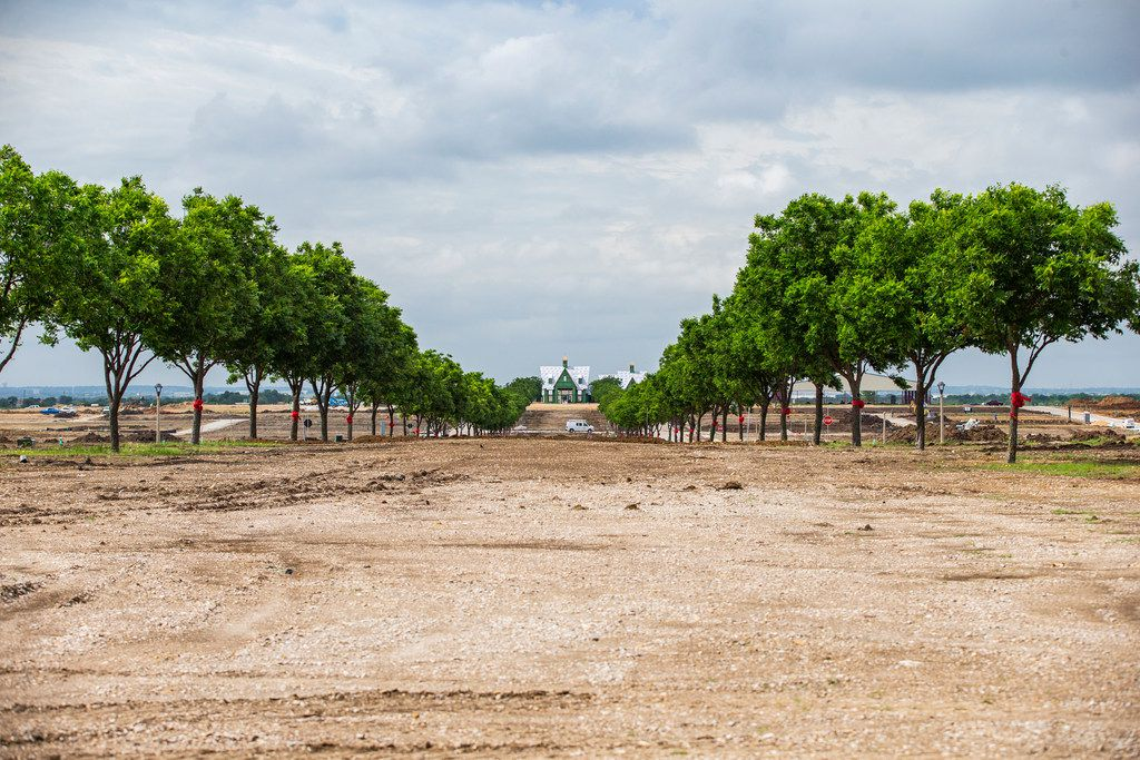 The view of Jackson Hall from the community entry includes rows of Pecan trees at a new Hillwood residential community called Pecan Square in Northlake.. Jackson Hall will serve as a community building for the development.
