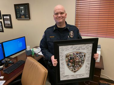 Police Chief James Brandon is pictured back in his office after returning to work following cancer treatment.