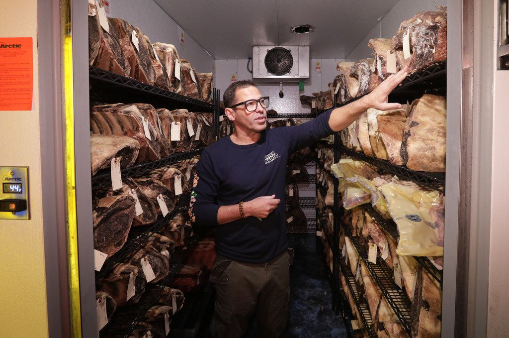 Executive chef John Tesar checks on Knife's aged meats at the Shops at Willow Bend in Plano. The restaurant opened in mid October.