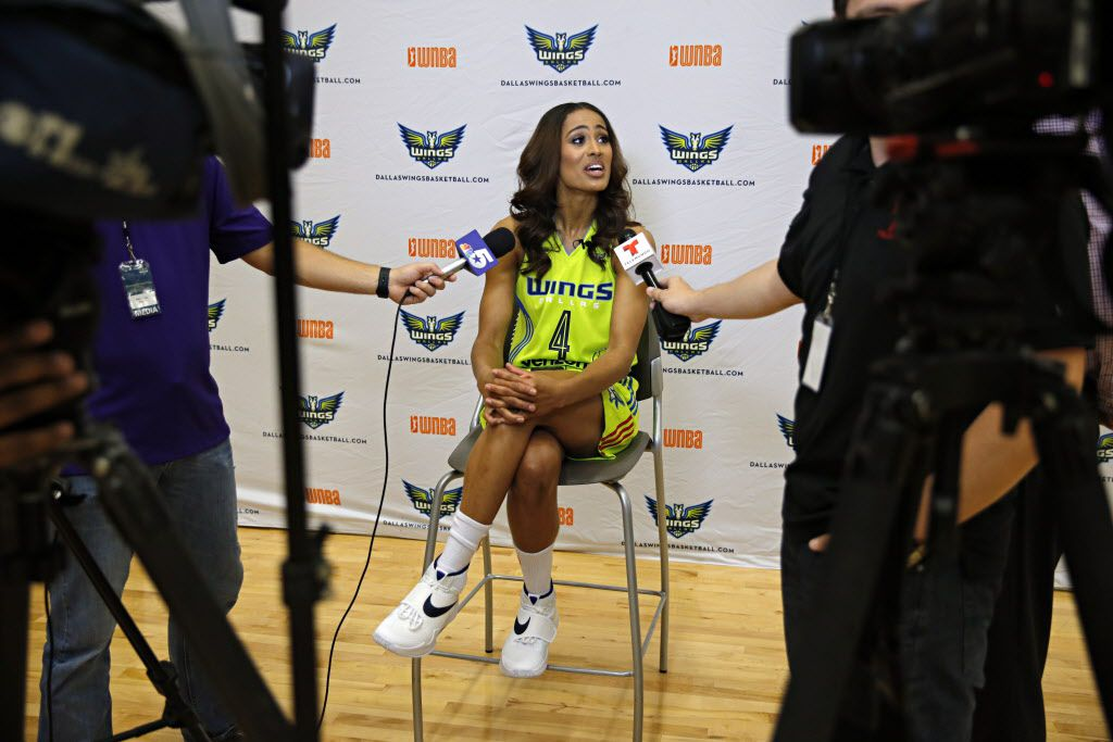 Dallas Wings guard Skylar Diggins (center) talks to reporters during a media day for the new WNBA team Monday, May 5, 2016 in Arlington, Texas. (G.J. McCarthy/The Dallas Morning News)