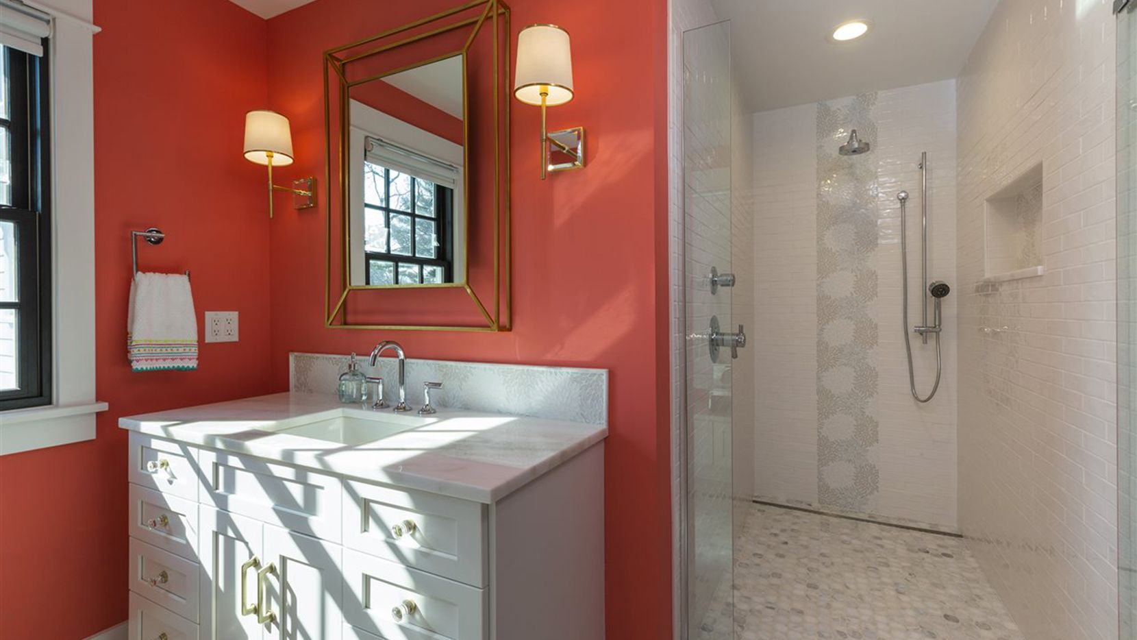 Modern bathrooms can be fitted with towel warmers and heated floors, among other features.