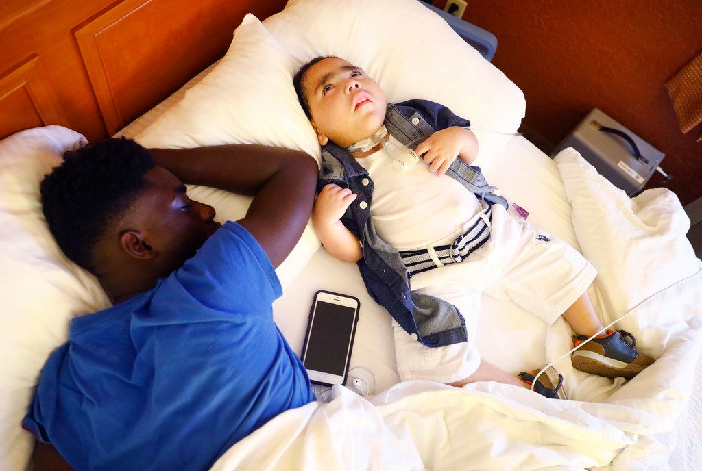 D'ashon Morris, 3, of Mesquite, Texas (right) lies awake on a hotel bed alongside his sleeping brother Emmanuel Faabe, 16, after his mother Linda Badawo dressed him in an Austin hotel, Wednesday, June 20, 2018. Badawo drove her family through the early morning hours to get to Austin for a Texas House Committee on Human Services meeting to discuss recent information reported by The Dallas Morning News regarding Medicaid managed care and the Health and Human Services Commission.