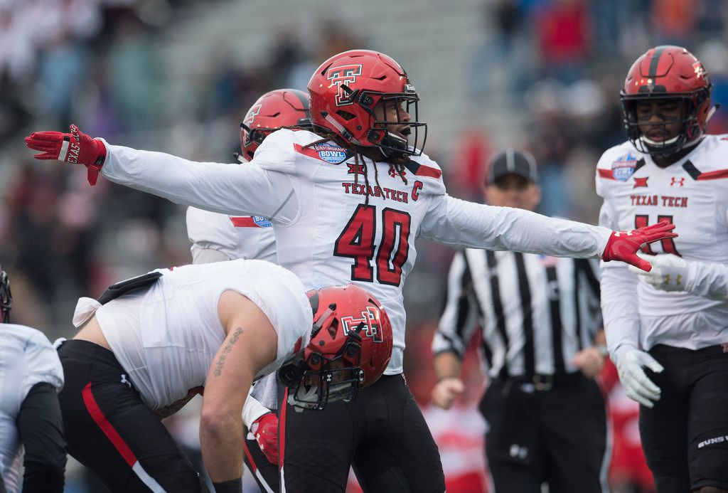 Texas Tech linebacker Dakota Allen (40) celebrates after a stop on fourth down during the Birmingham Bowl NCAA college football game, Saturday, Dec. 23, 2017 in Birmingham, Ala. (AP Photo/Albert Cesare)