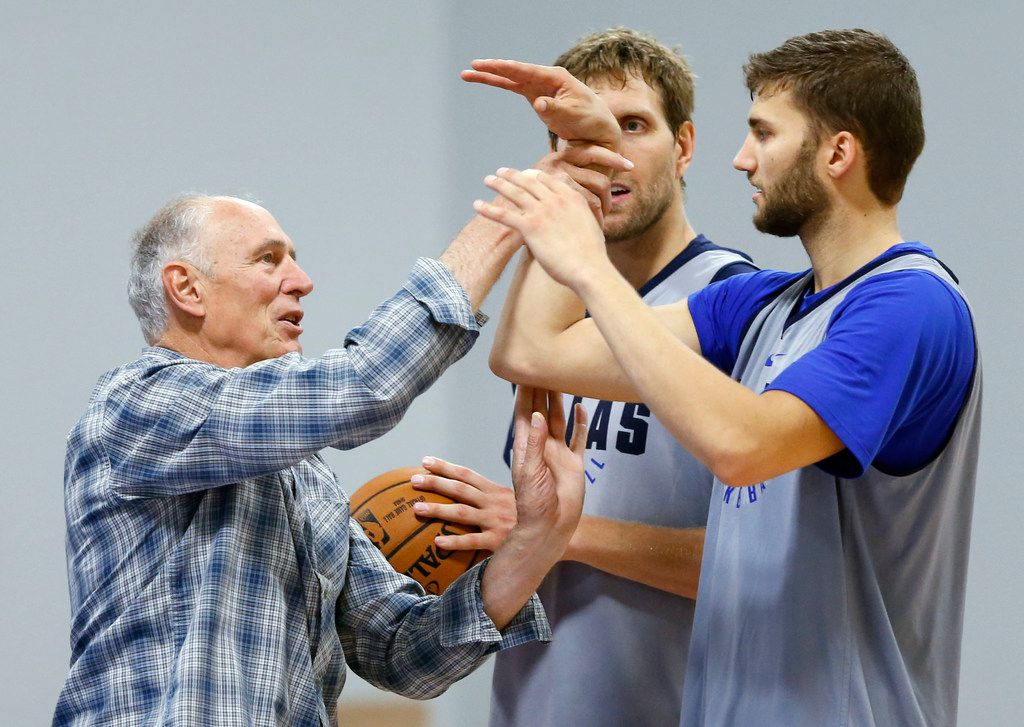 Holger Geschwindner works with Dallas Mavericks forward Maxi Kleber (42) as Dallas Mavericks forward Dirk Nowitzki (41) watches during training camp at the Dallas Mavericks practice facility in Dallas on Thursday, September 28, 2017. (Vernon Bryant/The Dallas Morning News)