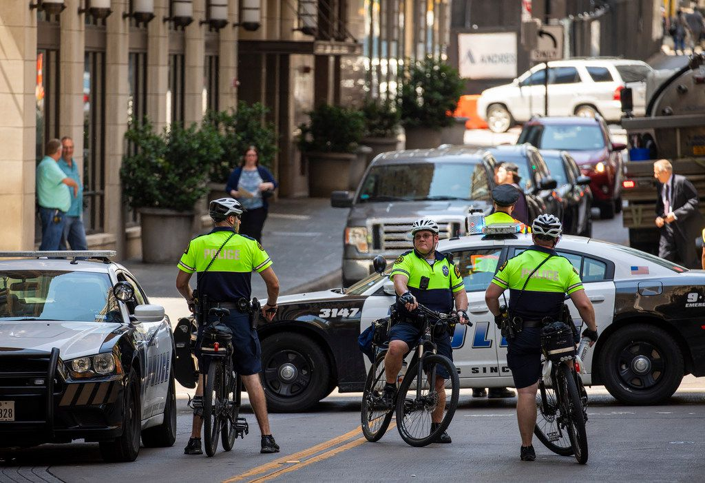 Dallas police block streets downtown before the arrival of President Donald Trump at The Adolphus Hotel for a fundraiser on Thursday, May 31, 2018, in Dallas. (Smiley N. Pool/The Dallas Morning News)