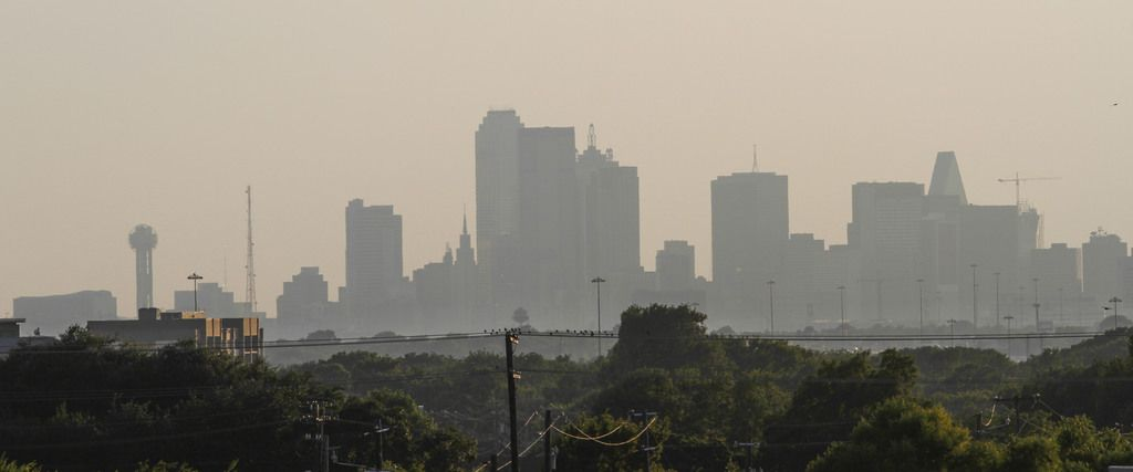 This file photo shows smog in downtown Dallas.