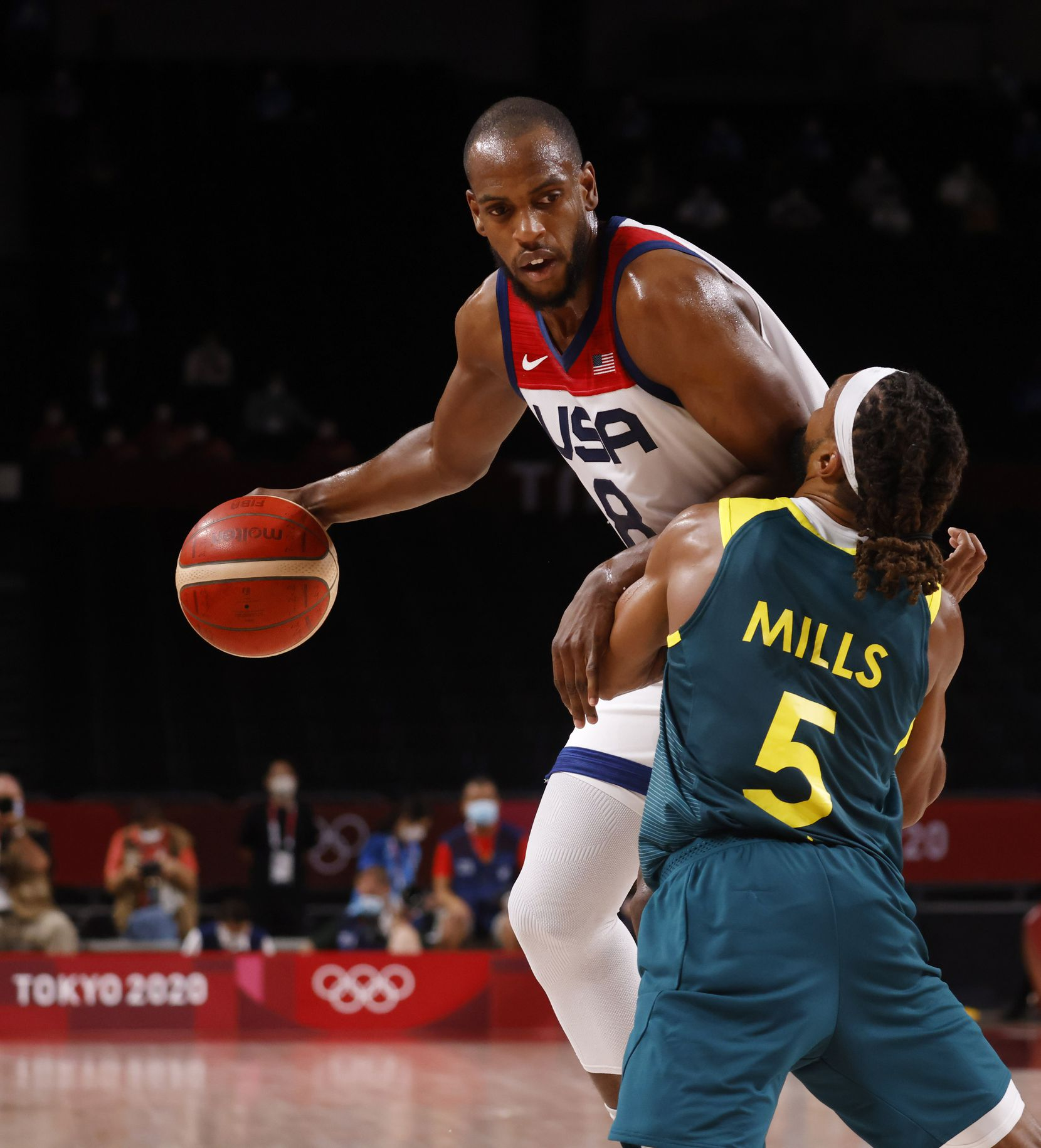 USA's Khris Middleton (8) posts up Australia's Patty Mills (5) during the second half of a men's basketball semifinal at the postponed 2020 Tokyo Olympics at Saitama Super Arena, on Thursday, August 5, 2021, in Saitama, Japan. USA defeated Australia 97-78 to advance to the gold medal game. (Vernon Bryant/The Dallas Morning News)