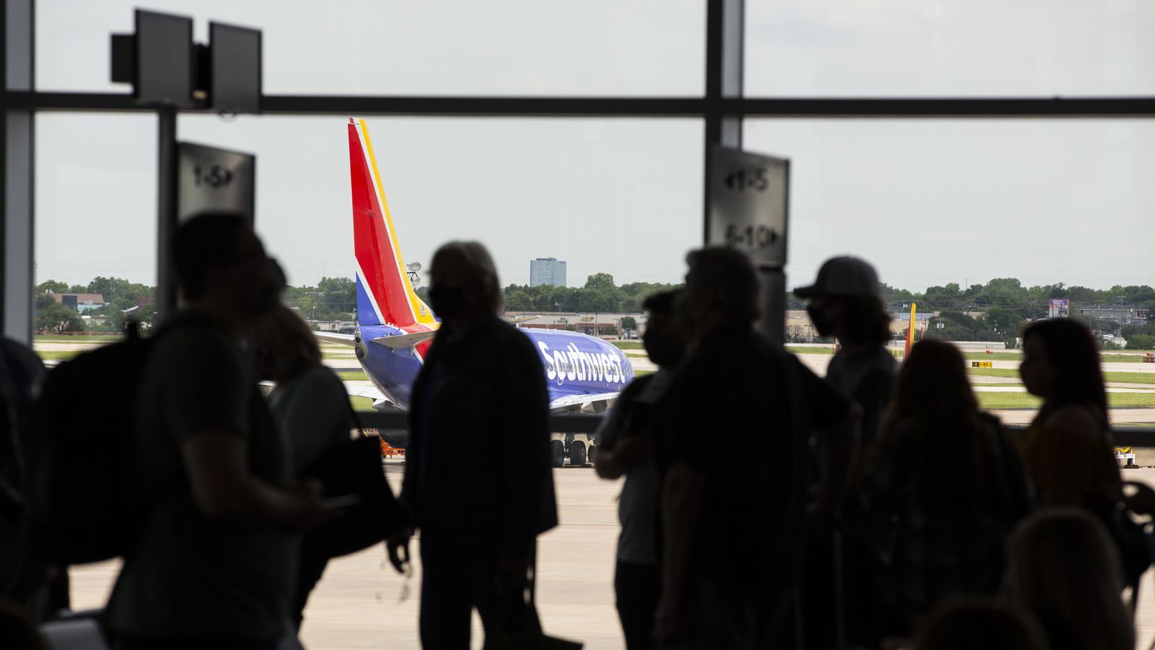 Passengers board a flight to New Orleans at Dallas Love Field in Dallas, Wednesday, May 19, 2021. (Brandon Wade/Special Contributor)