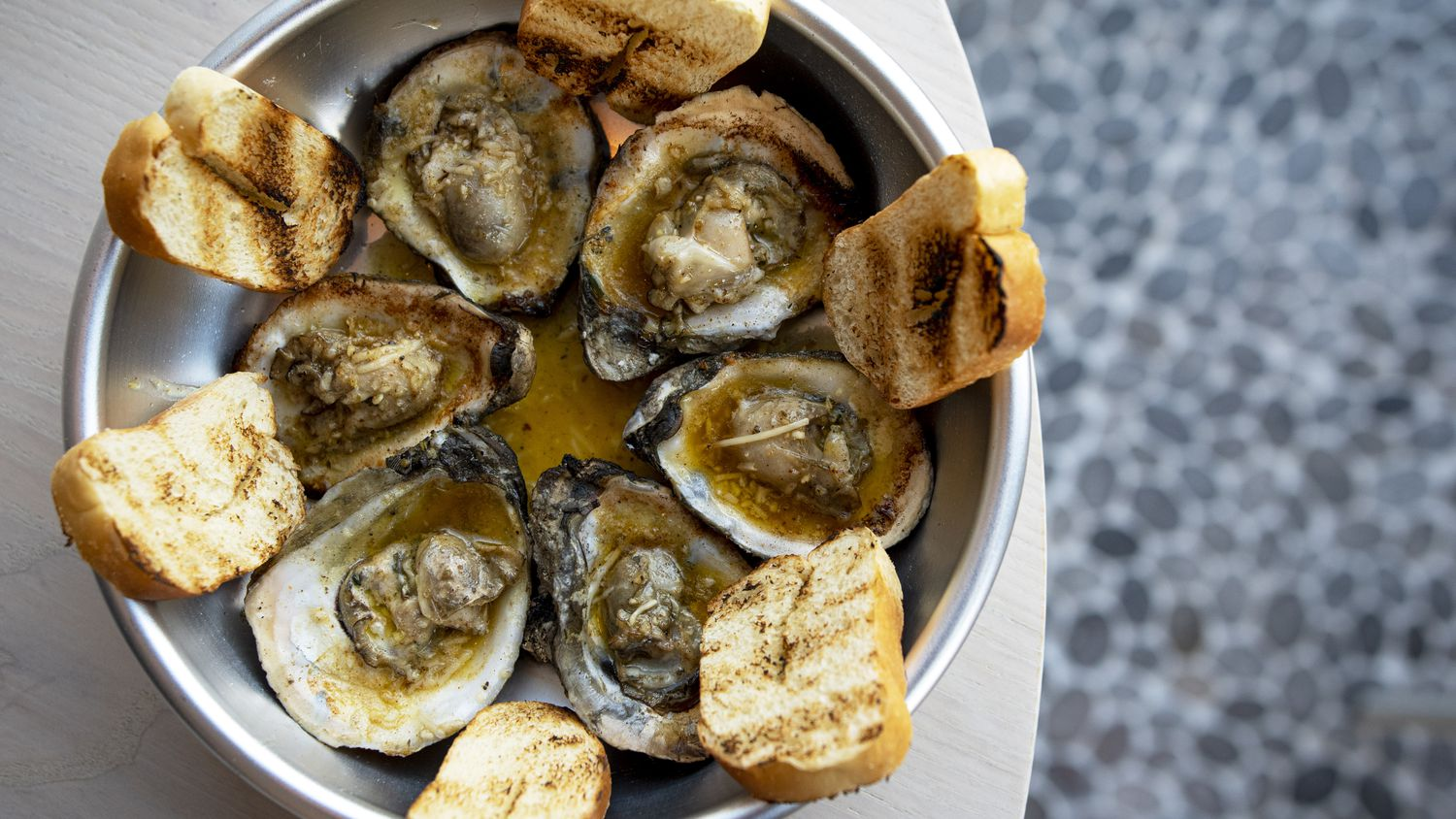 Chargrilled oysters are on the menu at Krio restaurant in the Bishop Arts District.