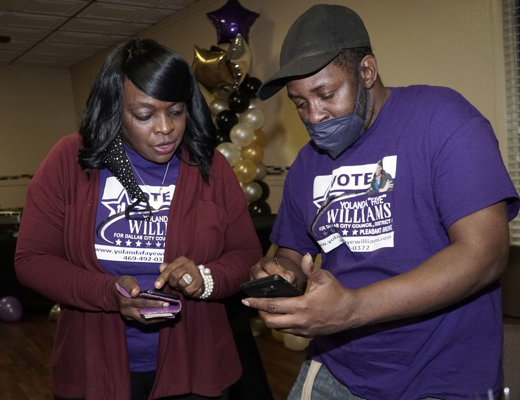 """District 5 Candidate Yolanda """"Faye"""" Williams looks at election updates with Rodirick Ellis (cq) at a watch party at New Millennium Bible Fellowship in Dallas, Texas on Saturday May 1, 2021. (Lawrence Jenkins/Special Contributor)"""