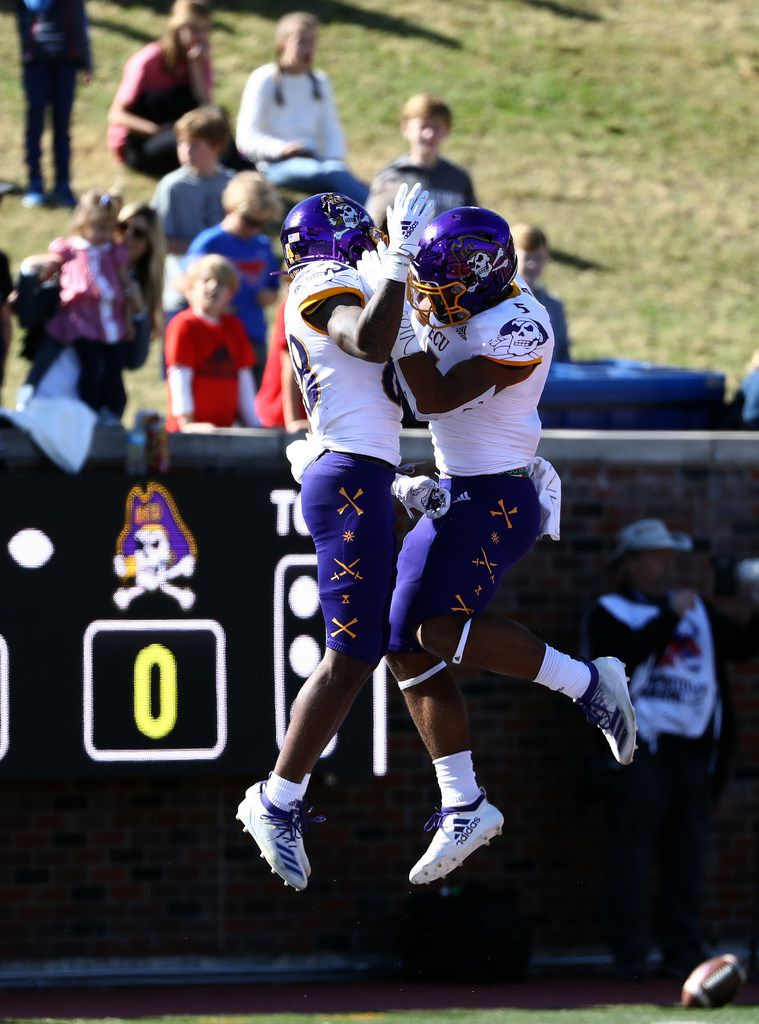 DALLAS, TEXAS - NOVEMBER 09:  Jsi Hatfield #88 of the East Carolina Pirates celebrates a touchdown with C.J. Johnson #5 in the first half against the Southern Methodist Mustangs at Gerald J. Ford Stadium on November 09, 2019 in Dallas, Texas. (Photo by Ronald Martinez/Getty Images)