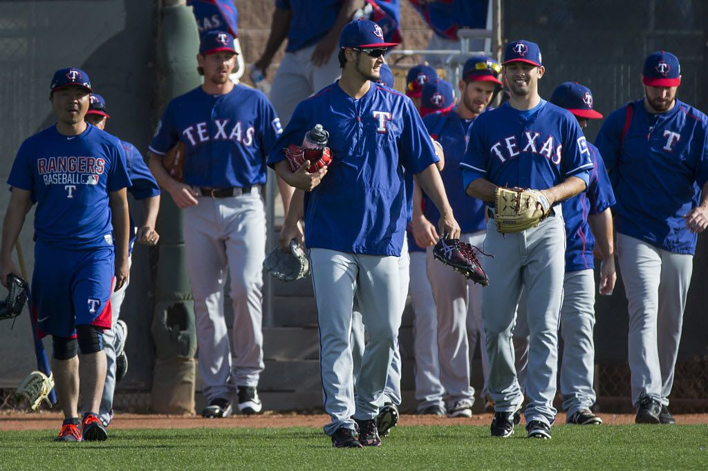 Texas Rangers pitcher Yu Darvish leads the way as Rangers players take the field for a spring workout at the team's training facility on Tuesday, March 1, 2016, in Surprise, Ariz. (Smiley N. Pool/The Dallas Morning News)