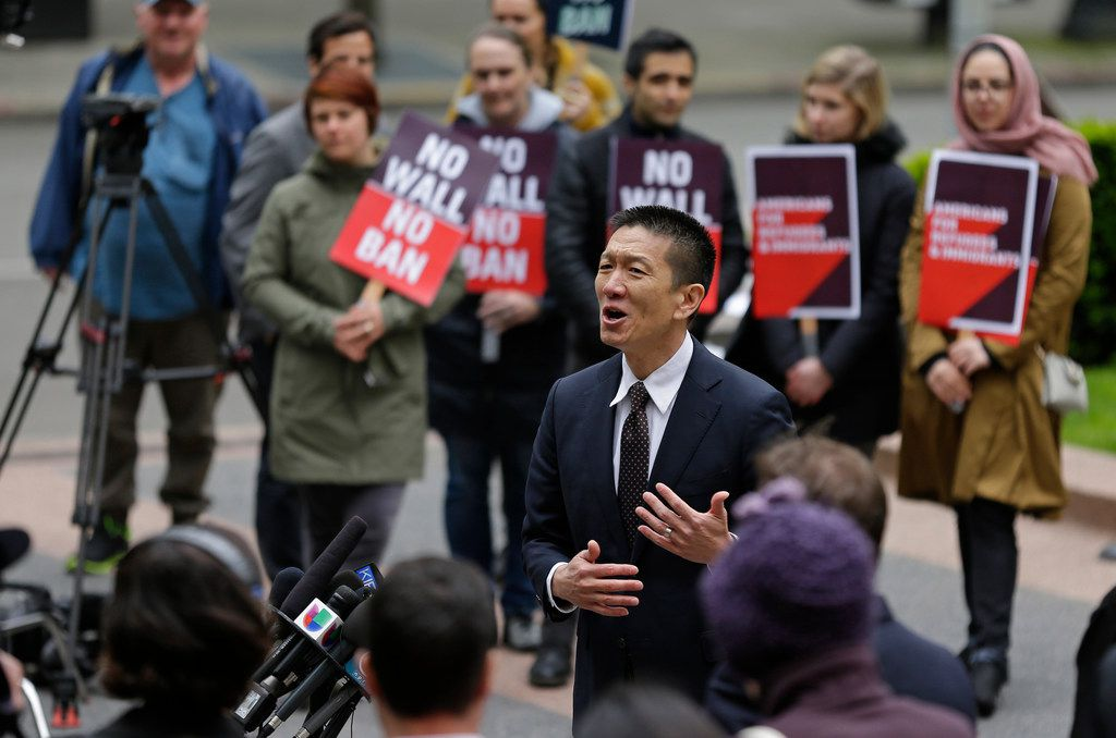 Hawaii Attorney General Doug Chin talks to reporters on May 15 outside a federal courthouse in Seattle, where a lawsuit was filed to halt enforcement of President Donald Trump's travel ban.
