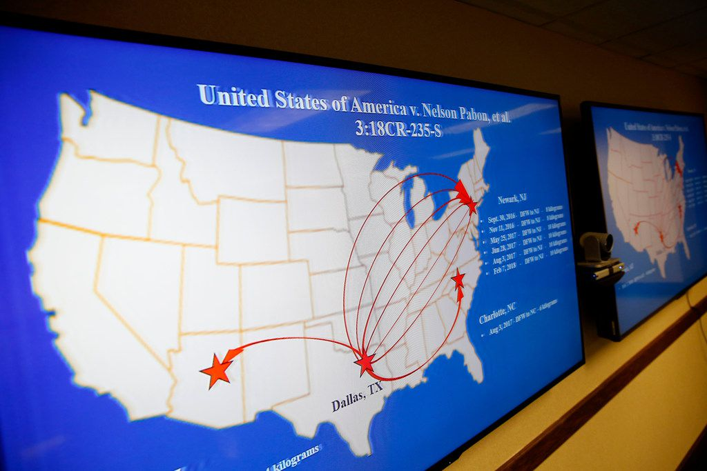 A map shows when and where individuals transported fake contraband out of DFW International Airport. The map was displayed during a news conference at the Earle Cabell Federal Building and Courthouse in Dallas. A federal grand jury has returned an indictment charging 10 individuals for their role in conspiring to traffic contraband through the airport.