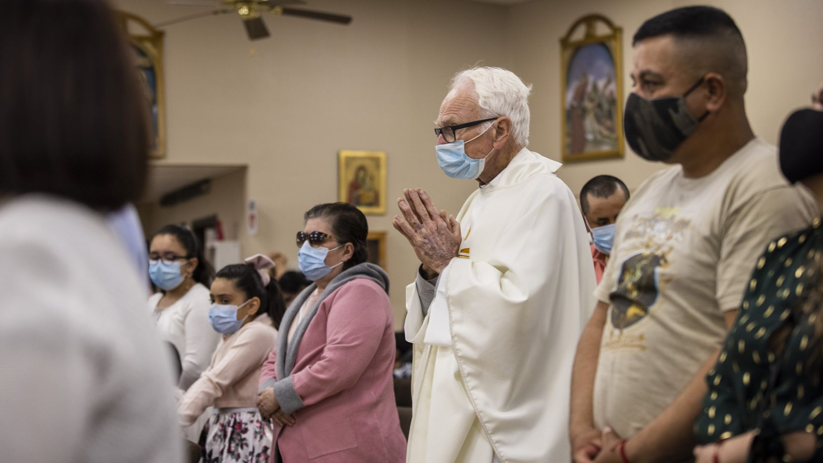 The Rev. Timothy Gollob proceeds to the sanctuary of Corpus Christi Catholic Parish to deliver a Spanish Easter Mass in Ferris.