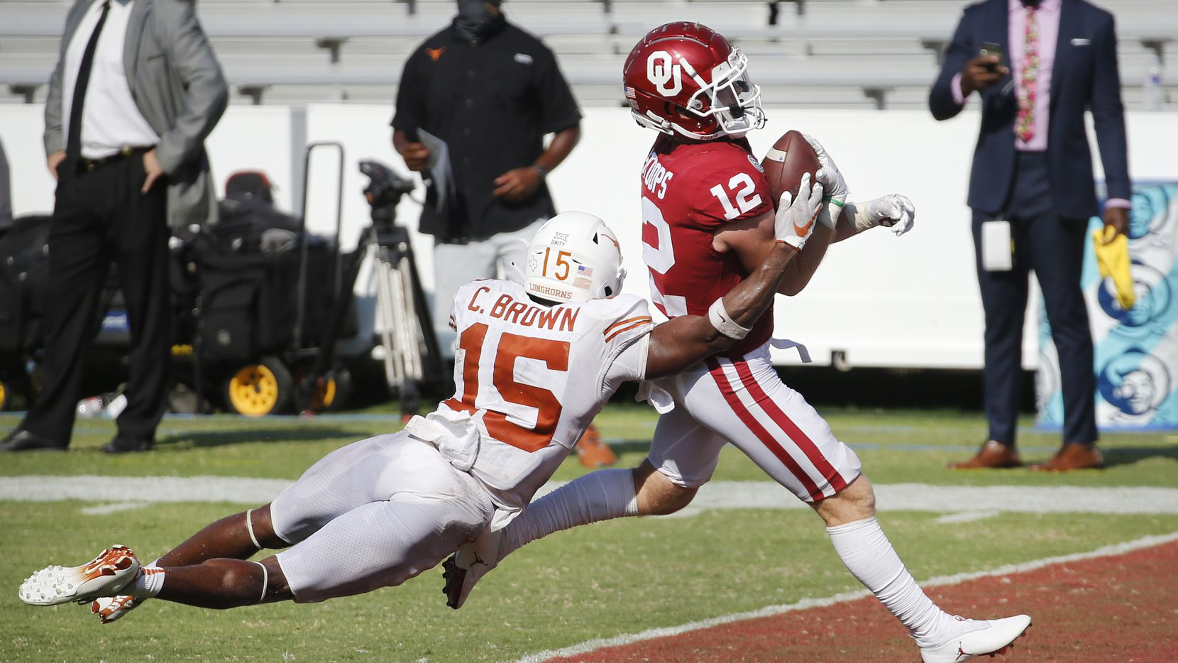 Oklahoma Sooners wide receiver Drake Stoops (12) crosses the goal line for the winning touchdown as Texas Longhorns defensive back Chris Brown (15) attempts the tackle in quadruple overtime at the Cotton Bowl in Dallas, Saturday, October 10, 2020. Oklahoma won the Red River Rivalry, 53-45.