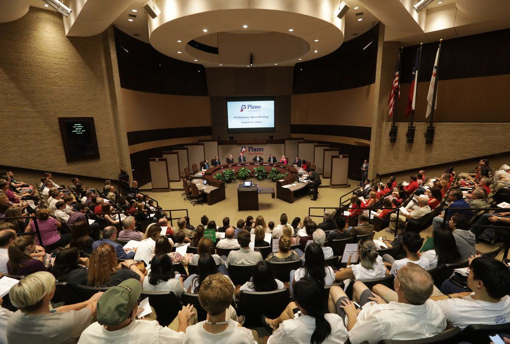 Community members listen during a City Council meeting at the Plano Municipal Center. Under a new state law, the audience is allowed to comment on agenda items as they occur.