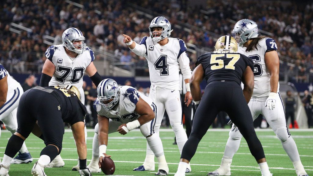 Dallas Cowboys quarterback Dak Prescott (4) calls out a play during the first half of a matchup between the Dallas Cowboys and the New Orleans Saints on Thursday, Nov. 29, 2018 at AT&T Stadium in Arlington, Texas.