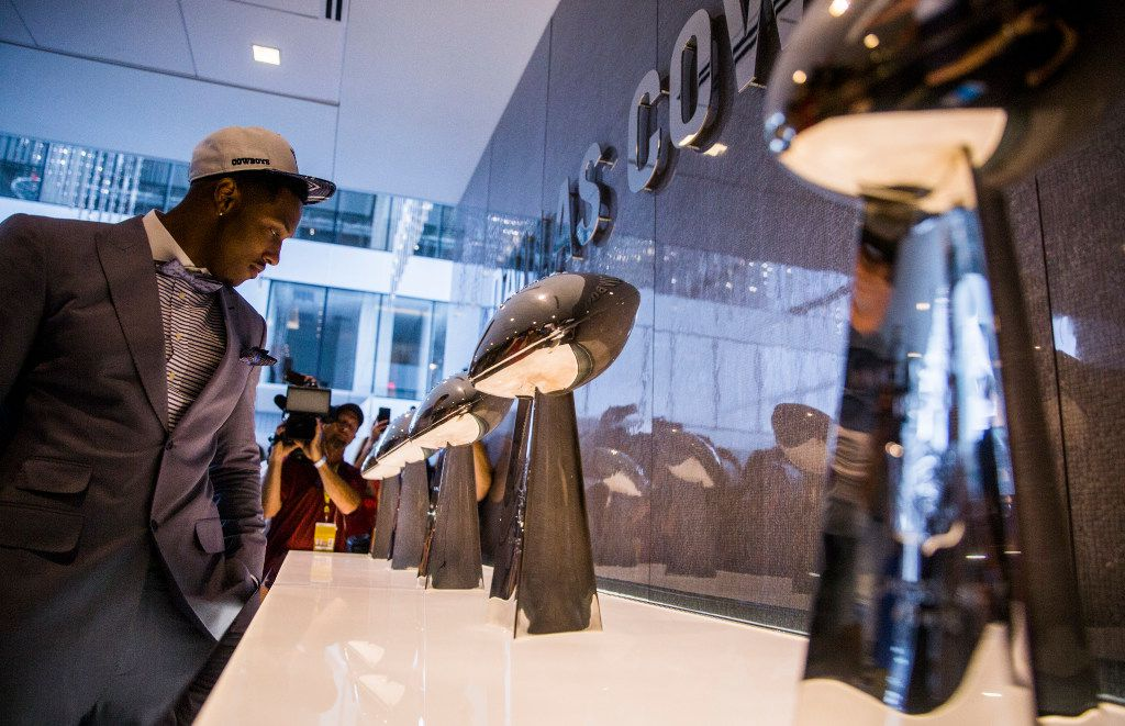 The Dallas Cowboys first round draft pick, defensive end Taco Charlton, looks at championship trophies on display on Friday, April 28, 2017 at The Star in Frisco, Texas. (Ashley Landis/The Dallas Morning News)