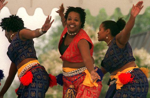Benita Maxie, Ray-Nita Powell and Marsha Boone of Thoissan Nu Afrikan, a West African style dance group, performed at the Martin Luther King, Jr. Community Center's annual Juneteenth Celebration in 1999.