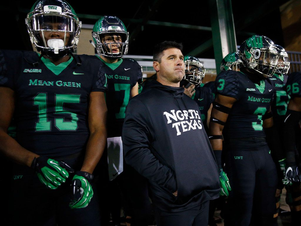 North Texas Mean Green head coach Seth Littrell and his players wait to be introduced before facing the Florida Atlantic Owls at Apogee Stadium in Denton, Texas, Thursday, November 15, 2018.