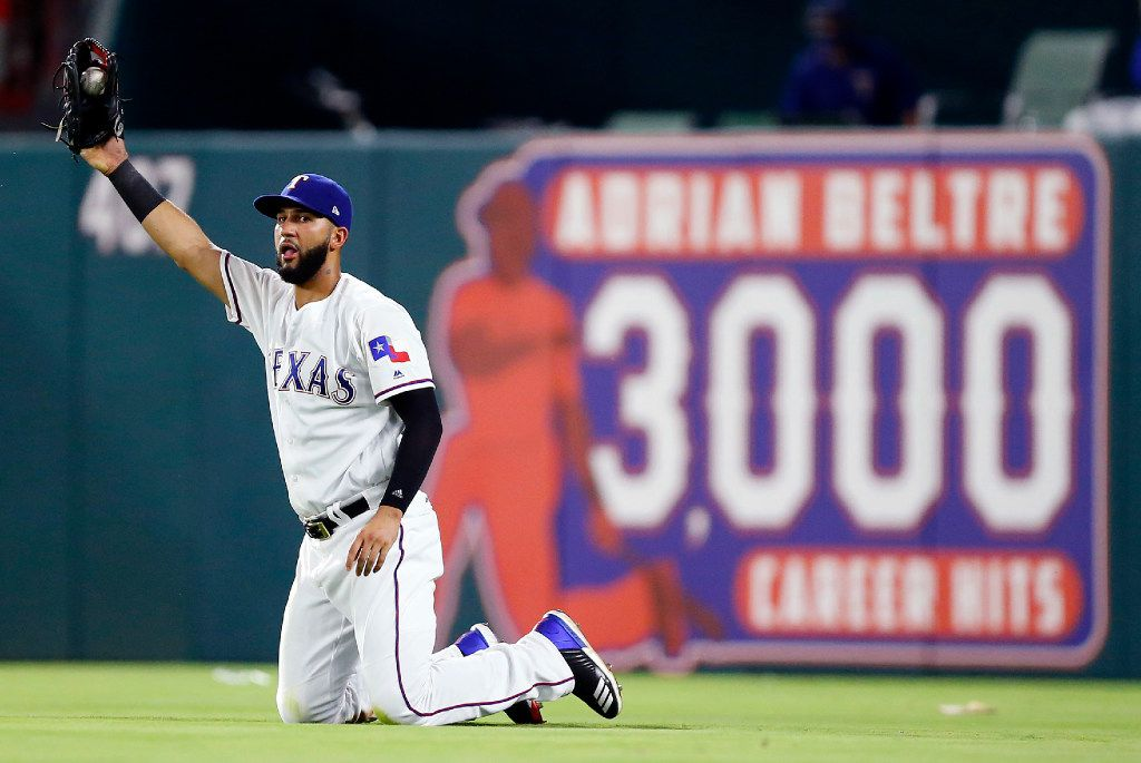 Texas Rangers right fielder Nomar Mazara (30) comes up with a diving catch to end the top of the eighth inning at Globe Life Park in Arlington, Friday, August 11, 2017. Houston Astros Brian McCann was out.