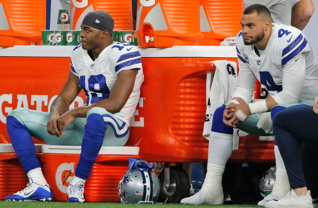 Dallas Cowboys Amari Cooper (19) and Dak Prescott (4)  are pictured in the bench area as time winds down in the fourth quarter of Dallas' 23-0 loss during the Dallas Cowboys vs. the Indianapolis Colts NFL football game at Lucas Oil Stadium in Indianapolis on Sunday, December 16, 2018. (Louis DeLuca/The Dallas Morning News)