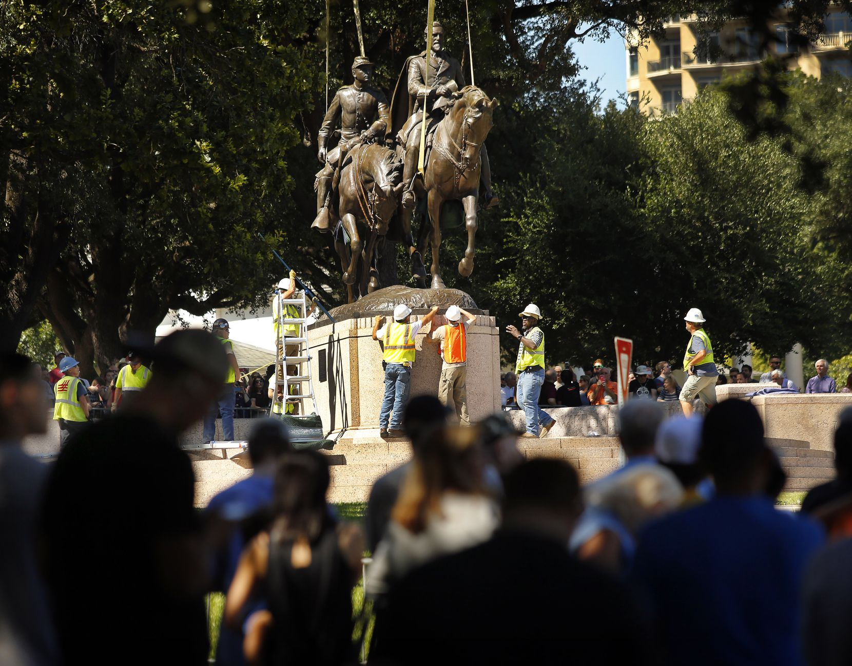 People gathered all afternoon to watch as crews from Howell Crane and Rigging Inc. tried to remove the Robert E. Lee statue from Robert E. Lee Park in Dallas on Sept.  6, 2017.