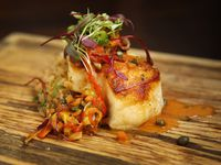 Primo's MX Kitchen & Lounge in Dallas is an upscale Tex-Mex restaurant. Beyond tacos and combo plates, the restaurant sells dishes like sea bass Veracruz made with tomato confit, capers, olives and Spanish rice.