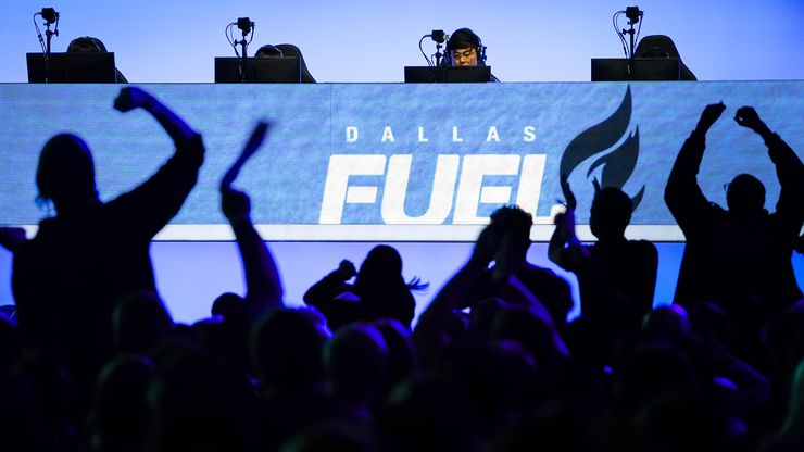 """Fans cheer as Noh """"Gamsu"""" Youngjin of the Dallas Fuel (center) and his teammates compete in an Overwatch League match against the Los Angeles Valiant at the Arlington Esports Stadium on Saturday, Feb. 8, 2020, in Arlington."""