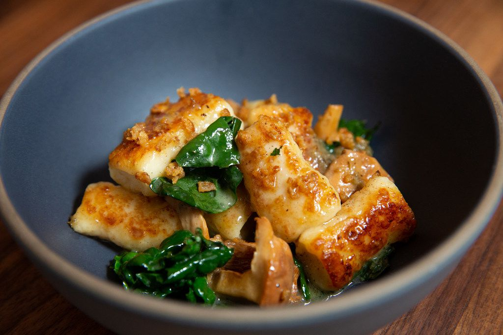 Ricotta gnocchi with chanterelles, kale and charred onion vinaigrette
