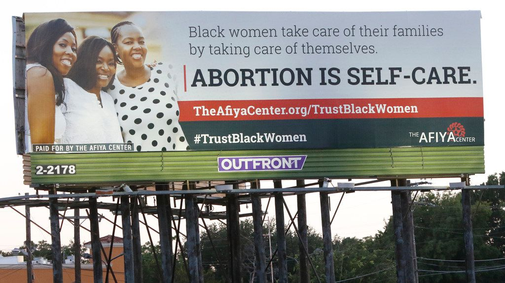"""A billboard put up by the Dallas-based Afiya Center proclaims """"abortion is self-care"""" and includes the hashtag TrustBlackWomen. Posted at Interstate 35E and Illinois Avenue in Oak Cliff, the billboard follows another recent abortion message, the Black Pro Life Coalition's assertion that """"abortion is not healthcare."""""""
