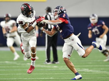 In this file photo from 2019, Denton Ryan plays against Colleyville Heritage with Ryan wide receiver Billy Bowman Jr. (2) and Heritage cornerback Dylahn Mckinney (16) battling for possession of the ball.