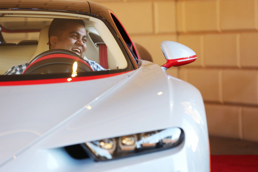 Vehicle owner Mayur Shree sits in the Bugatti Chiron during an event put on by Park Place commemorating the first delivery of a Bugatti Chiron to Texas at the Residences at The Stonleigh in Dallas Friday January 12, 2018. The Chiron was a gift for Shree's father. The car is capable of traveling over 260 miles per hour and has ten radiators, quad turbos and is valued at $3.2 million. (Andy Jacobsohn/The Dallas Morning News)
