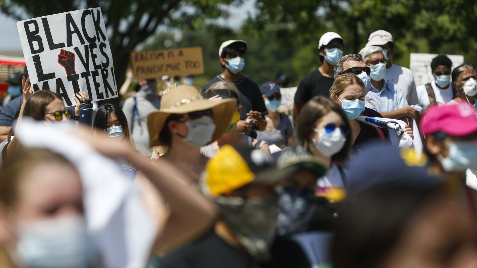 People gather at the Plano Municipal Building for the Hungry for Change Rally on Sunday, June 7, 2020, in Plano, Texas. (Ryan Michalesko/The Dallas Morning News)