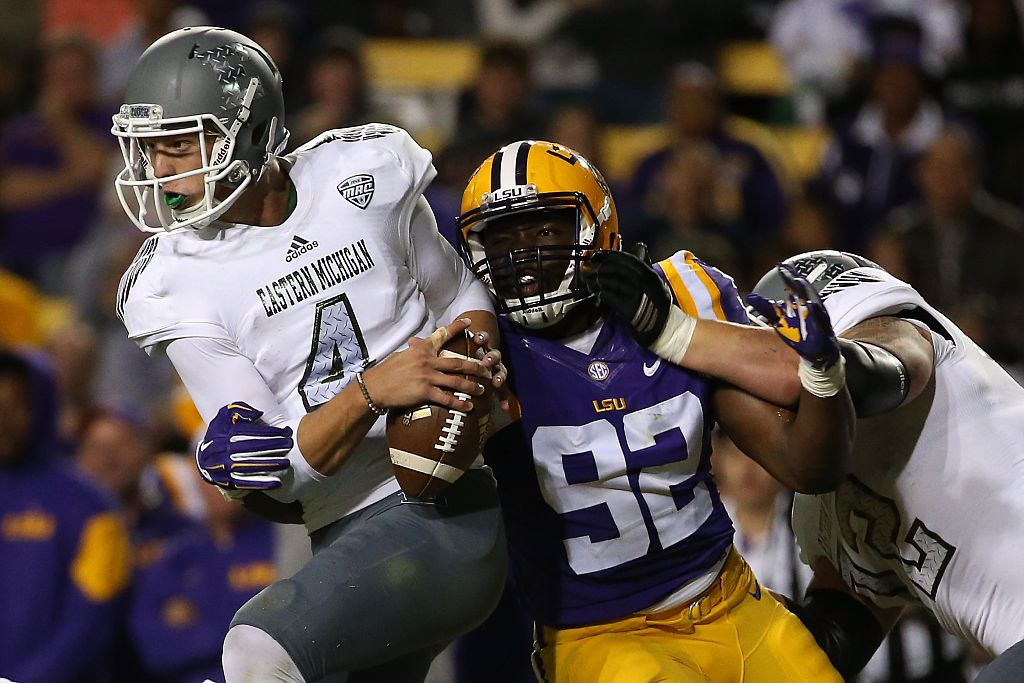 BATON ROUGE, LA - OCTOBER 03: Brogan Roback #4 of the Eastern Michigan Eagles is sacked by Lewis Neal #92 of the LSU Tigers at Tiger Stadium on October 3, 2015 in Baton Rouge, Louisiana. (Photo by Chris Graythen/Getty Images)