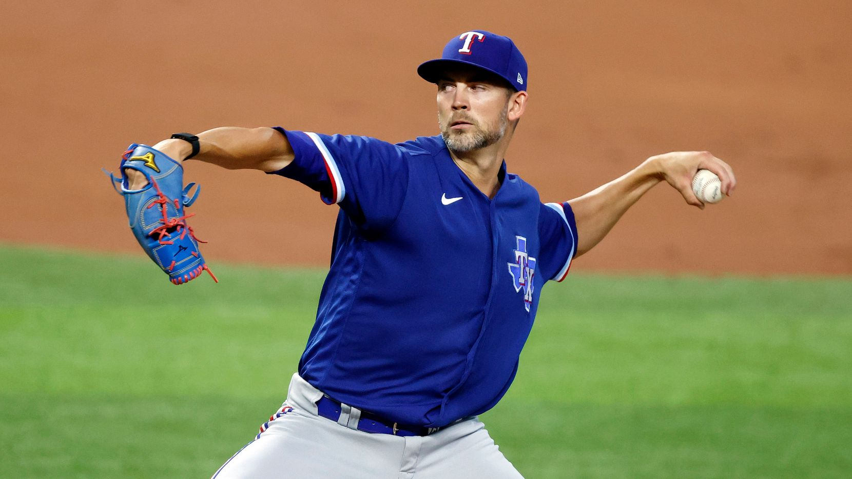 Texas Rangers starting pitcher Mike Minor throws from the mound during a simulated Summer Camp game inside Globe Life Field in Arlington, Texas, Thursday, July 9, 2020.