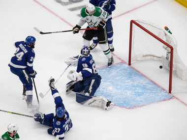 Corey Perry (10) of the Dallas Stars looks on as the puck sails past goaltender Andrei Vasilevskiy (88) of the Tampa Bay Lightning during Game One of the Stanley Cup Final at Rogers Place in Edmonton, Alberta, Canada on Saturday, September 19, 2020.